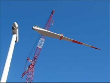 Wind turbine being assembled in Chile. Photo by Green Energy, from Wikimedia Commons.