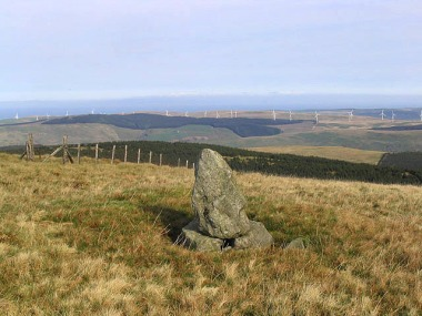 Haggis Hill in Ayrshire with wind farm in background. Photo by Walter Baxter. Wikimedia Commons.
