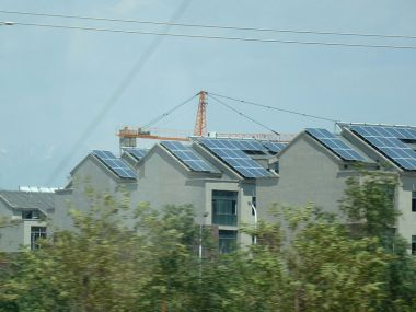 Solar PVs on Chinese rooftops. Photo by Ismoon. GNU Free Documentation License. [Wikimedia Commons]