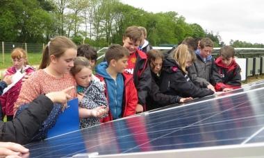 Children inspect panels at a UK solar farm. Photograph: Primrose Solar/PA.