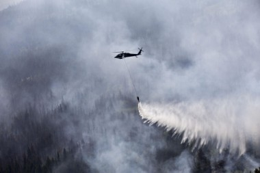 An Alaska Army National Guard helicopter drops water on the Stetson Creek Fire near Cooper Landing, Alaska, on June 17 2015. Photo by Sgt. Balinda O'Neal, US Army National Guard.