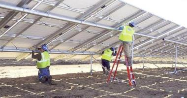 Workers install a SunEdison/First Wind solar project in Massachusetts. The company is one of the developers that has a contract to sell power to Idaho Power.  Provided by First Wind.