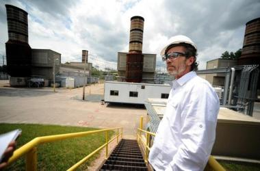 Kevin Thornton, a spokesman for Exelon, leads a tour of the power company's existing Summer Street plant in Medway earlier this summer. Daily News Staff Photo/Allan Jung
