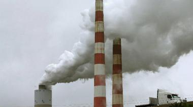 Emissions spew out of a large stack at the coal-fired Morgantown Generating Station in Newburg, Maryland. Scott Tong