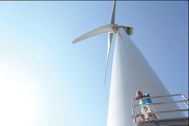 David Blittersdorf stands on one of the four wind turbines of the Georgia Mountain Community Wind project in northwest Vermont. Elodie Reed