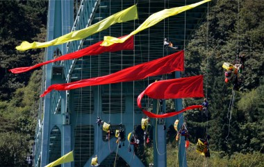 Protesters hang from bridge in Portland to block oil rig exit. AP Photo/Don Ryan