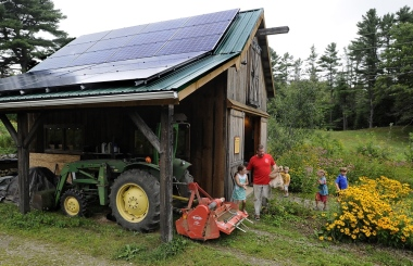 New solar panels cover the roof of a barn at Little Ridge Farm. Photo by Gordon Chibroski, Portland Press Herald Staff Photographer.
