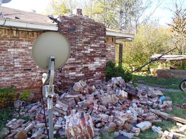 House damage in central Oklahoma from the magnitude 5.6 earthquake. Photo by Brian Sherrod, USGS. Public domain.