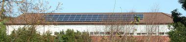 Array of Solar Panels, Saintfield High School, Northern Ireland. Photo by Peter Clarke. CC BY SA 3.0.