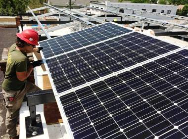 Char Colwell of Sundance Power Systems, installing a solar array in North Carolina. Photo courtesy of Sundance Power Systems