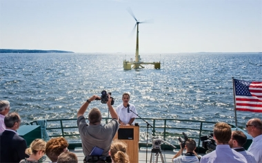 Habib Dagher, director of UMaine's Advanced Structures and Composites Center, in front of the VolturnUS prototype wind turbine deployed off the shores of Castine in 2014. Mainebiz file photo / James McCarthy