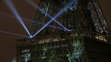 The Eiffel Tower was lit up on Sunday evening in support of the climate conference. Reuters