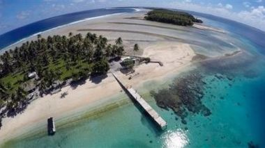 Climate change poses an existential threat to places like the Marshall Islands, which protrude only 6 feet (2 meters) above sea level in most places. (AP Photo/Rob Griffith)