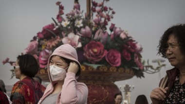 A woman in China wears a mask to counter pollution. Getty Images