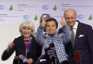 Laurence Tubiana, Christiana Figueres, and Laurent Fabius applaud the Paris Agreement