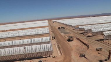 Rows of curved mirrors capture solar energy at the Ouarzazate plant in Morocco