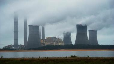 The coal-fired Plant Scherer is shown in operation early Sunday, June 1, 2014, in Juliette, Ga. AP