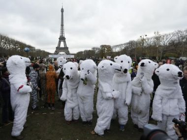 Activists in white bear costumes during the COP21 Conference. (Photo: Matt Dunham/AP)