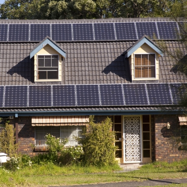 Rooftop solar panels via Shutterstock