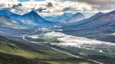 Alaska's famous Dalton Highway runs through the valley of the slow moving landslides. UAF