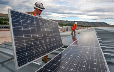 Contractors work on solar panels at the Department of Energy's National Renewable Energy Laboratory (NREL) in Golden, Colorado.
