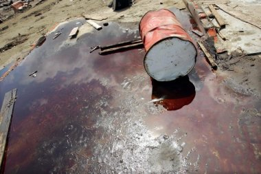 A barrel lies in a pool of oil at a damaged petroleum plant after an earthquake in Indonesia. Spencer Platt via Getty Images