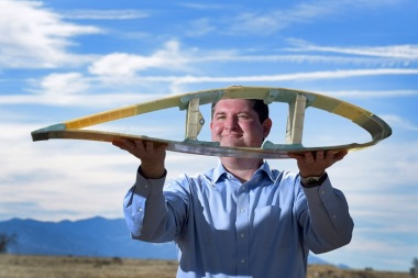 Todd Griffith shows a model of the cross-section of a 50-meter blade. (Photo by Randy Montoya)