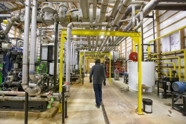 Andrew Sloat, at Green Cow Power in Goshen, walks through the engine room. SBT Photo/Becky Malewitz