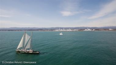 Greenpeace Ship Rainbow Warrior Sailing past the destroyed Fukushima Daiichi nuclear plant.