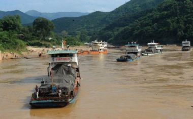 A boat makes its way down the Mekong River near the proposed Pak Beng Dam site, downstream of Chiang Khong district, Chiang Rai.
