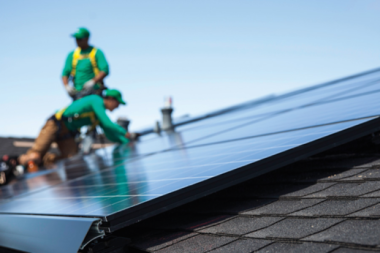 Workers for SolarCity install rooftop solar on a house. Credit: SolarCity