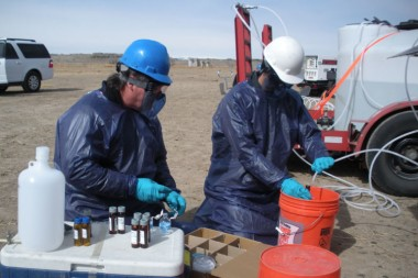 US EPA staff members sample a monitoring well for contaminants from hydraulic fracturing. (Photo: Dominic DiGiulio)
