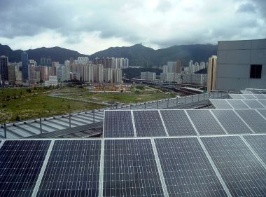 Clouds and solar panels. Image via Wikimedia Commons