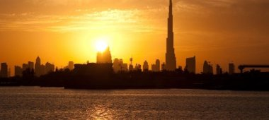 Sun setting over downtown Dubai. Taken from Festival City by the_dead_pixel via Flickr (CC BY SA, 2.0 License)