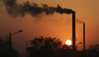 Smoke curls from a chimney at a factory in Ahmadabad, India. (Ajit Solanki / Associated Press)
