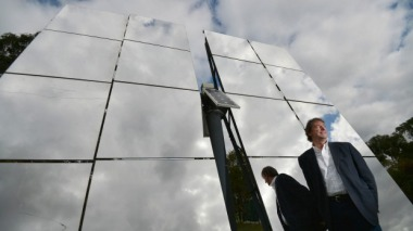 John Lasich, CTO at RayGen, stands in front of mirrors for concentrating solar power. Photo: Joe Armao