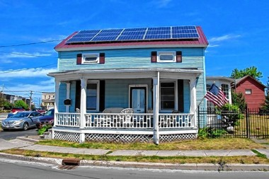 Rooftop solar panels are an increasingly large part of New England's power grid. Associated Press