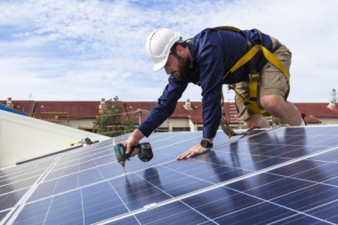 Solar panel installation. Image via Shutterstock