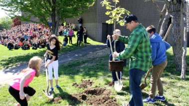 Chad Pregracke and his nonprofit surprised students by planting the group's millionth tree at their school.