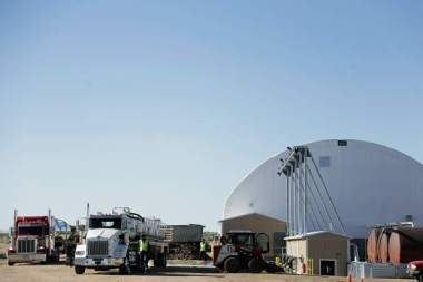 Trucks sit outside A1 Organic's facilities on Weld County Road 49. Eliott Foust | The Greeley Tribune