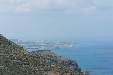 Wind farm on the Tunisian coast. Photo by IssamBarhoumi. CC BY-SA 4.0 international. Wikimedia Commons.