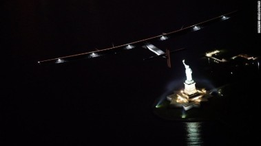 Solar Impulse 2 flies above the Statue of Liberty.