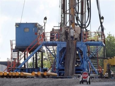 Drilling for gas. AP image.