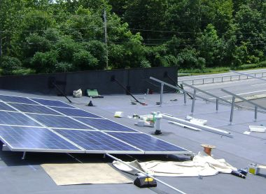 Solar installation under construction in New York State. Photo by Lucas Braun. CC BY-SA 3.0 unported. Wikimedia Commons