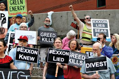 Protesters gather outside Exxon's shareholders meeting in Dallas. Ben Torres/Redux