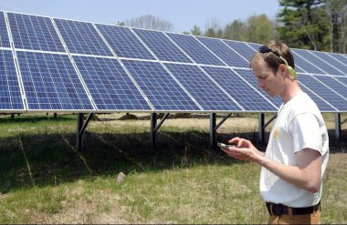 Hans Albee, an engineer at the ReVision Energy, at the Sky Ranch Solar Farm in Kennebec County, Maine. Andy Molloy/Kennebec Journal