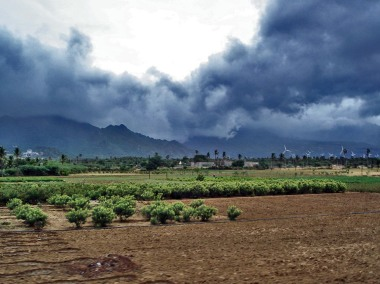 Advancing monsoon clouds over wind turbines in Tamil Nadu. Photo by w:user:PlaneMad. CC BY-SA 3.0. Wikimedia Commons.