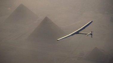 Solar Impulse 2 flies over the pyramids of Giza.