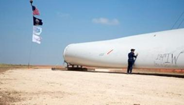 Signing a wind turbine blade at the Kingman Wind Energy Center.