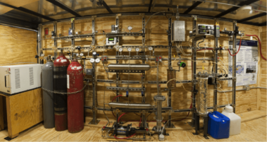 Interior of a mobile methanol synthesis trailer, hydrogen is produced and mixed with carbon dioxide for a fuel process. Photo courtesy of Steve Atkins.